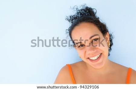 Young hispanic woman with a beautiful smile - stock photo