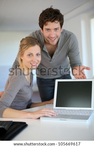 Young home students presenting e-learning service - stock photo