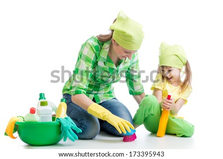 young housewife mother and her kid do homework together - stock photo