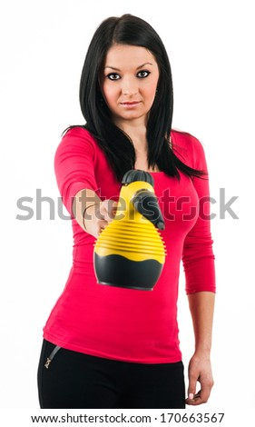 Young housewife prepares a steam cleaner to clean - stock photo