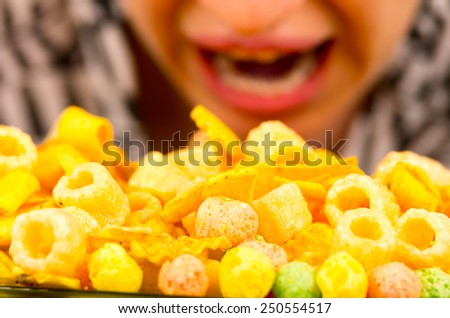 young hungry brunette girl overeating junk food closeup - stock photo