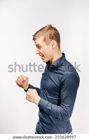 Young hunk shows his fist. He is strong and determined to fight. - stock photo