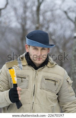 young hunter ready for hunt with his axe - stock photo
