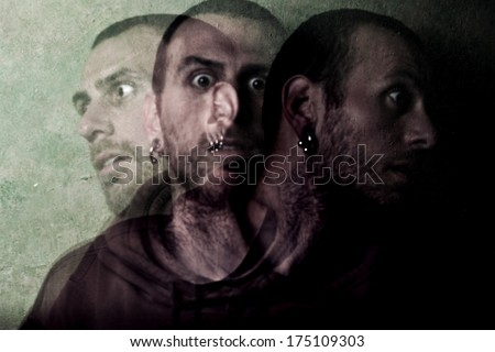 young ill man with schizophrenia  - stock photo