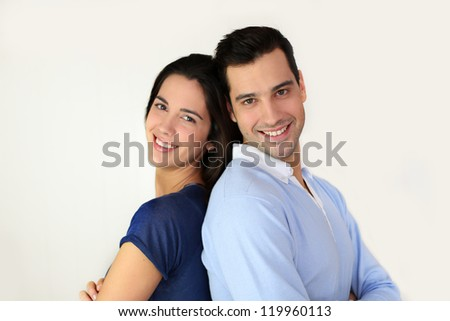 Young in love couple standing back to back - stock photo