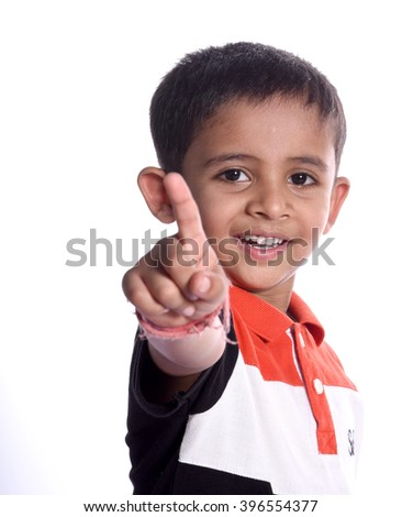 Young Indian boy giving the thumbs up - stock photo
