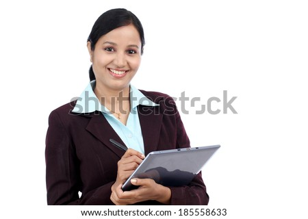 Young Indian business woman with tablet and stylus against white background - stock photo