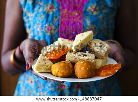 Young Indian Female Carrying Indian Diwali Sweets - stock photo
