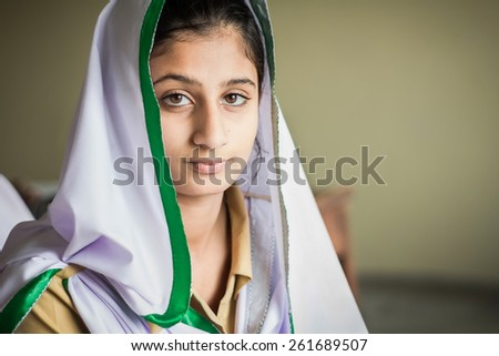 Young indian girl in class room - stock photo