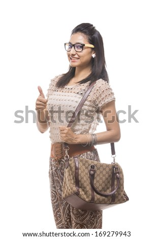 Young Indian girl with handbag posing to the camera - stock photo