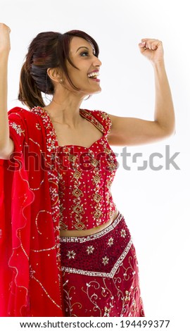 Young Indian woman celebrating success - stock photo