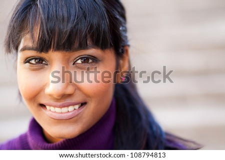 young indian woman face closeup - stock photo