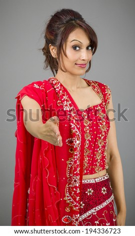 Young Indian woman offering hand for handshake - stock photo