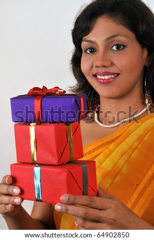 Young Indian woman with lots of gifts - stock photo