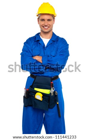 Young industrial contractor posing with crossed arms isolated over white background - stock photo