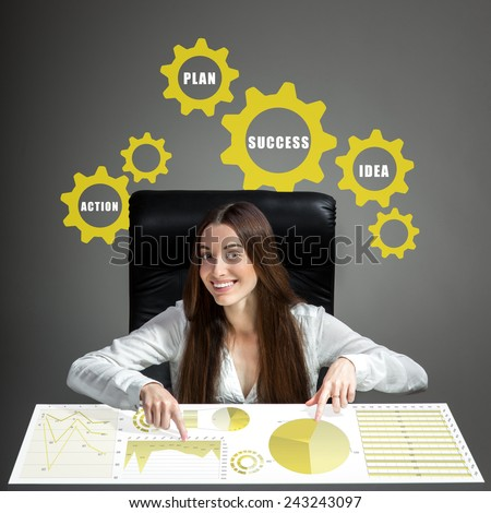 Young inventive woman analyzing business plan or business calculations - stock photo