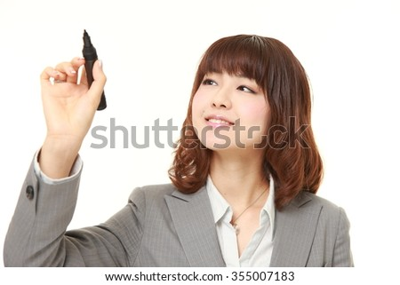 young Japanese businesswoman draw in the air - stock photo