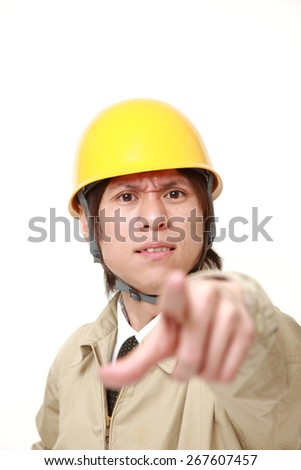 young Japanese construction worker scolding - stock photo