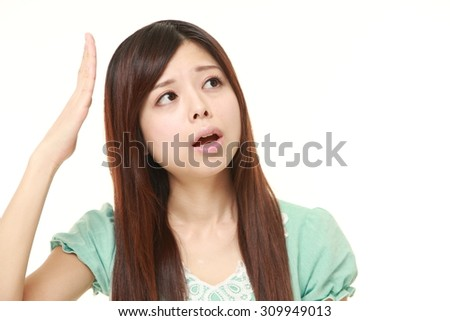 young Japanese woman has lost her memory - stock photo