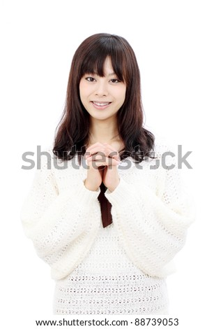 Young japanese woman holding hands together and smiling - stock photo