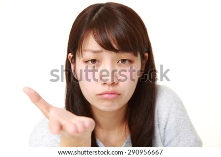 young Japanese woman scolding  - stock photo