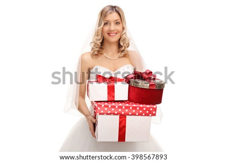 Young joyful bride holding a bunch of wedding presents isolated on white background - stock photo