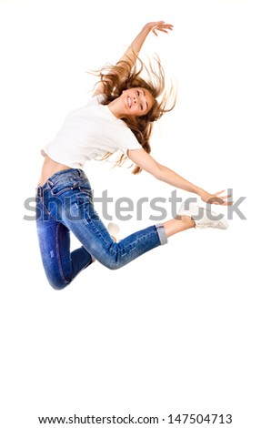 young jumping girl isolated on a white background - stock photo