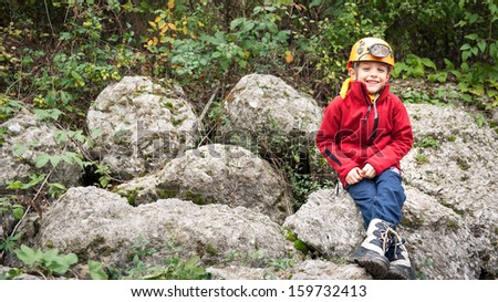 Young kid portrait with helmet for cave exploration.  - stock photo