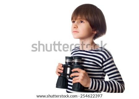 Young kid with binocular, isolated on white background - stock photo