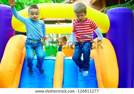 young kids having fun on playground - stock photo