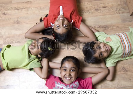 young kids huddled together - stock photo