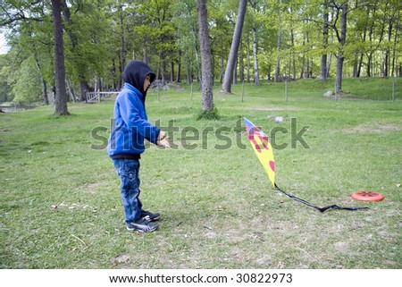Young kite runner - stock photo