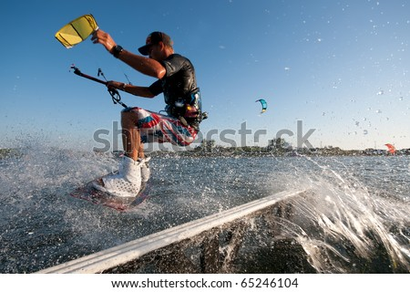young kiter slides on rail at jib contest - stock photo