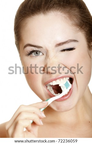 young lady brushing her teeth, isolated on white - stock photo