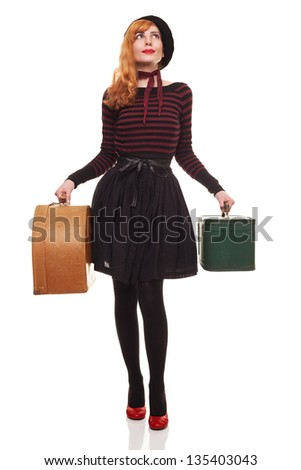 young lady carrying suitcases waiting her vehicle to arrive isolated on white background - stock photo