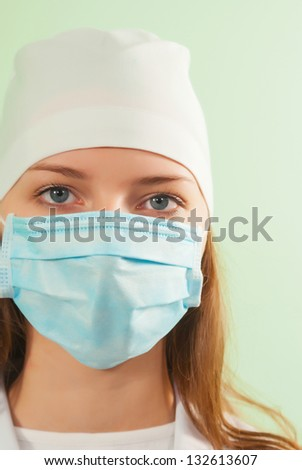 Young lady doctor against light background - stock photo