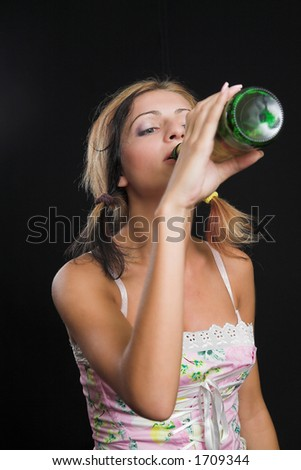 Young lady drinking from a beer bottle - very high resolution - stock photo