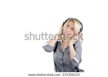 Young lady in a headset enjoying music - stock photo
