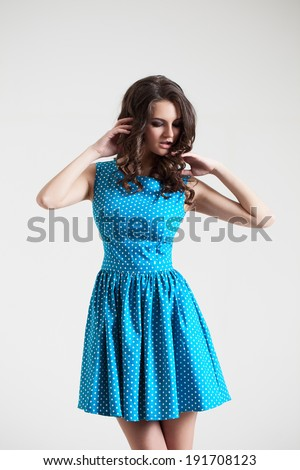 Young lady in color dress. Fashion portrait in studio. Sexy beautyful dress - stock photo