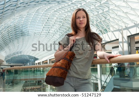 young lady in the shopping mall - stock photo
