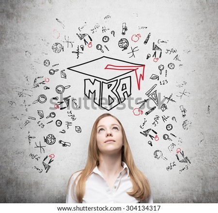 Young lady is thinking about MBA degree. Drawn a graduation hat and the range of educational icons on the concrete background . - stock photo