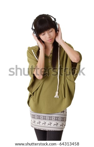 Young lady listening music, closeup portrait over white background. - stock photo