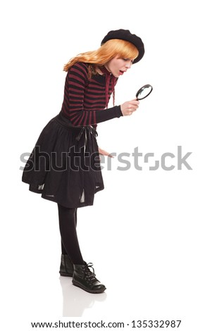young lady looking at something with magnifying glass isolated on white background - stock photo