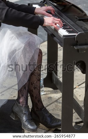 Young lady playing electric piano  - stock photo