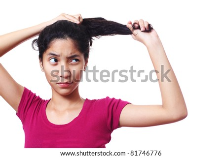 young lady stretching her curly hair - stock photo