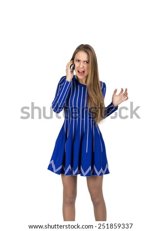 Young lady talking on the phone. Caucasian lady talking on the phone and expressing anger and fury - stock photo