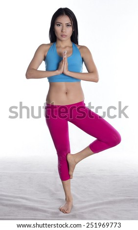 Young lady yoga exercise on white background - stock photo