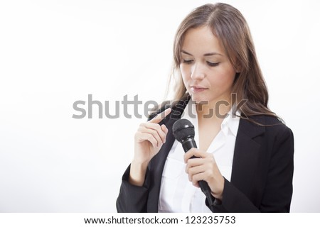 Young latin business woman testing sound for a conference - stock photo