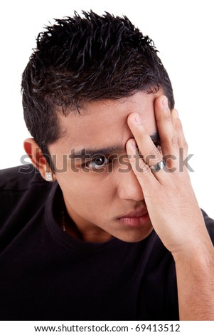 young latin man, pensive, with his hand on front of eyes , isolated on white background, studio shot - stock photo
