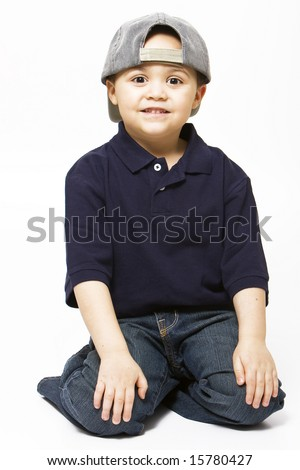 Young latino boy wearing baseball cap - stock photo